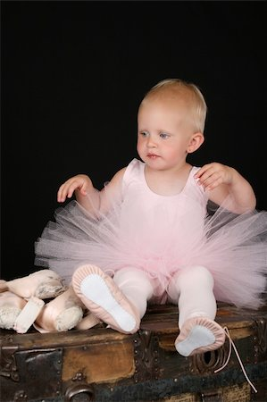 Beautiful blond baby wearing a ballet costume sitting ontop of antique trunk Stock Photo - Budget Royalty-Free & Subscription, Code: 400-05315079