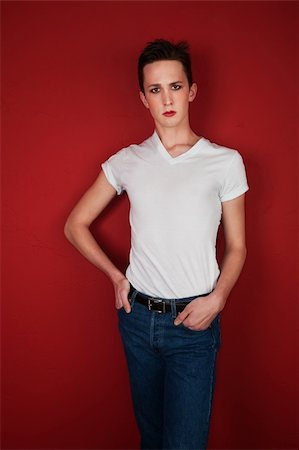 Young Caucasian homosexual with his hands in pocket on maroon background Stock Photo - Budget Royalty-Free & Subscription, Code: 400-05317311