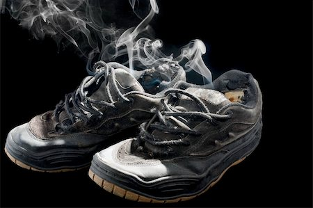 pair of smelly old sneakers on a black background Stock Photo - Budget Royalty-Free & Subscription, Code: 400-05318197