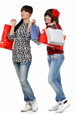 Two friends shopping with gift bags in hand Stock Photo - Budget Royalty-Free & Subscription, Code: 400-05310189
