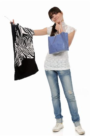 young woman shopping. In her hand is a blouse on a hanger and a bag Stock Photo - Budget Royalty-Free & Subscription, Code: 400-05310195