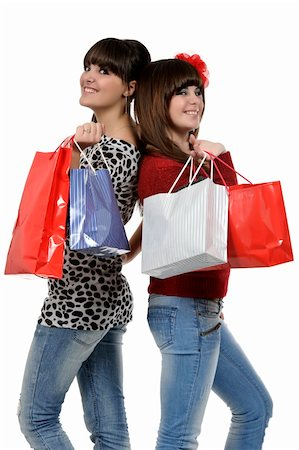 Two friends shopping with gift bags in hand Stock Photo - Budget Royalty-Free & Subscription, Code: 400-05310190