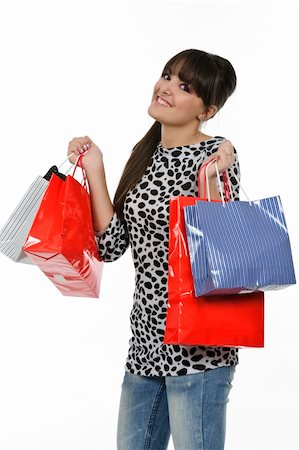 young woman shopping with gift bags in hand Stock Photo - Budget Royalty-Free & Subscription, Code: 400-05310191