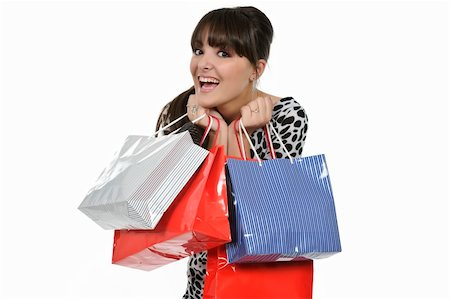 young woman shopping with gift bags in hand Stock Photo - Budget Royalty-Free & Subscription, Code: 400-05310192