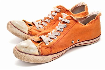 a pair of worn sneakers on a white background Stock Photo - Budget Royalty-Free & Subscription, Code: 400-05324257