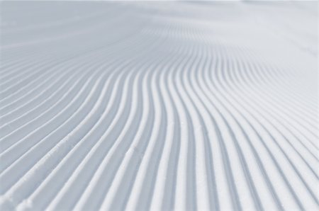 tracks on ski slopes in snow at beautiful sunny  winter day with blue sky Stock Photo - Budget Royalty-Free & Subscription, Code: 400-05328804
