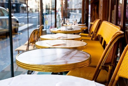 Street view of a Cafe terrace with empty tables and chairs,paris France Stock Photo - Budget Royalty-Free & Subscription, Code: 400-05321669