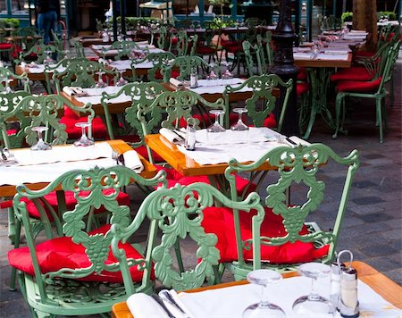 Street view of a Cafe terrace with empty tables and chairs,paris France Stock Photo - Budget Royalty-Free & Subscription, Code: 400-05321672