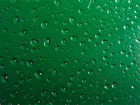 Close up of fresh drops of water on green background. Stock Photo - Budget Royalty-Free & Subscription, Code: 400-05321690