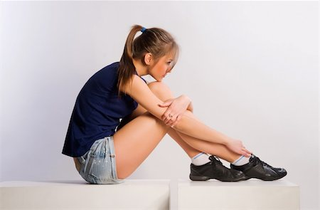 young girl sitting on cubes Stock Photo - Budget Royalty-Free & Subscription, Code: 400-05322171