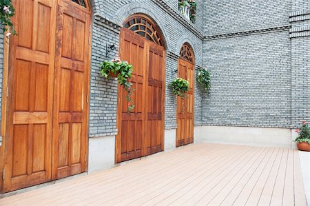 Traditional Chinese house  with wooden arch doors and deck,architectural style of Ming and Qing Dynasties Stock Photo - Budget Royalty-Free & Subscription, Code: 400-05338551