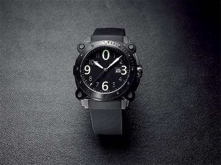 Gents wrist watch on a dark textured background Stock Photo - Budget Royalty-Free & Subscription, Code: 400-05339914