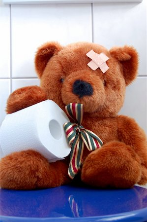 toy teddy bear with paper in the bathroom on toilet Stock Photo - Budget Royalty-Free & Subscription, Code: 400-05331455