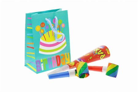 paper blower - Colorful gift bag and party blowers on white background Stock Photo - Budget Royalty-Free & Subscription, Code: 400-05333417