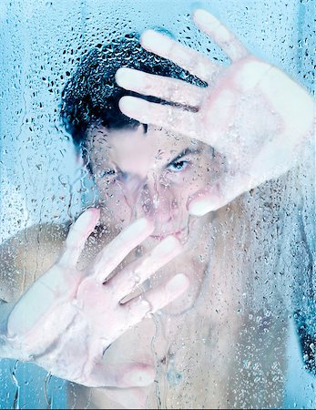 Young handsome man looking from a shower Stock Photo - Budget Royalty-Free & Subscription, Code: 400-05345002
