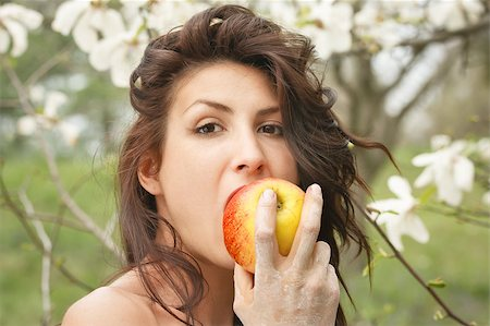 Beautiful young girl eating an apple in the park Stock Photo - Budget Royalty-Free & Subscription, Code: 400-05346923