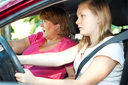 Teenage driver and her mother about to have a car accident. Stock Photo - Budget Royalty-Free & Subscription, Code: 400-05347529