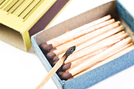 Open box of matches with one match burning Stock Photo - Budget Royalty-Free & Subscription, Code: 400-05348094