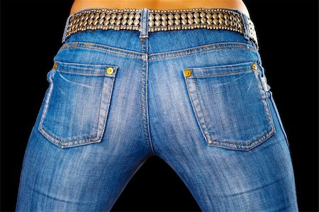 Sexy female ass dressed in jeans on black background Stock Photo - Budget Royalty-Free & Subscription, Code: 400-05349098
