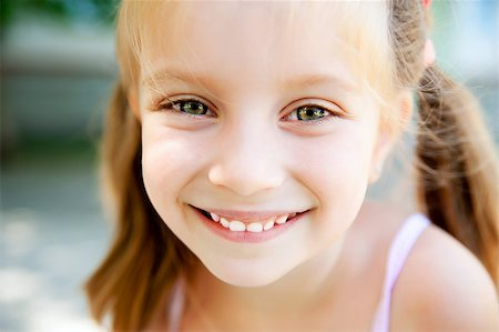 cute little girl smiling in a park close-up Stock Photo - Budget Royalty-Free & Subscription, Code: 400-05342069