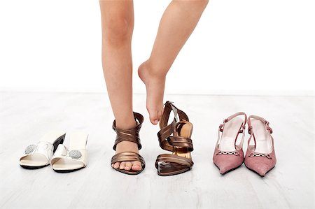 Child feet trying on adult shoes with high heels - closeup Stock Photo - Budget Royalty-Free & Subscription, Code: 400-05342947