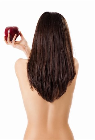 Topless female back to camera holding red apple in hand, isolated on white Stock Photo - Budget Royalty-Free & Subscription, Code: 400-05356274