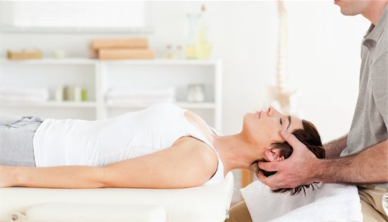 Chiropractor stretching a cute woman in a room Stock Photo - Royalty-Free, Artist: 4774344sean, Image code: 400-05357086