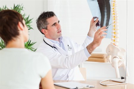 Male Doctor showing a patient a x-ray in a room Stock Photo - Budget Royalty-Free & Subscription, Code: 400-05357296