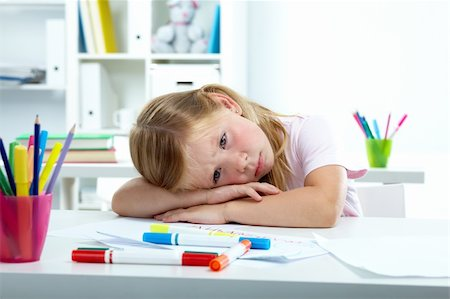 Portrait of sad girl putting her head on desk Stock Photo - Budget Royalty-Free & Subscription, Code: 400-05359307