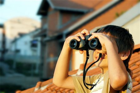 teen boy watching at black binoculars outdoor portrait Stock Photo - Budget Royalty-Free & Subscription, Code: 400-05351014