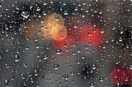 Raindrops on glass surface and blurry abstract city lights. Background texture. Stock Photo - Budget Royalty-Free & Subscription, Code: 400-05352513