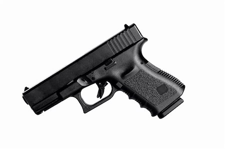 Image of a 40 caliber handgun on a white background Stock Photo - Budget Royalty-Free & Subscription, Code: 400-05352605