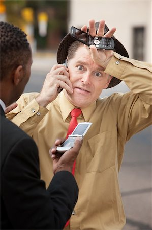 sweaty businessman - Worried businessmen on phone call on the street Stock Photo - Budget Royalty-Free & Subscription, Code: 400-05353757