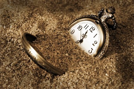 sand clock - A pocket watch is buried in the dirty sand. Stock Photo - Budget Royalty-Free & Subscription, Code: 400-05361553