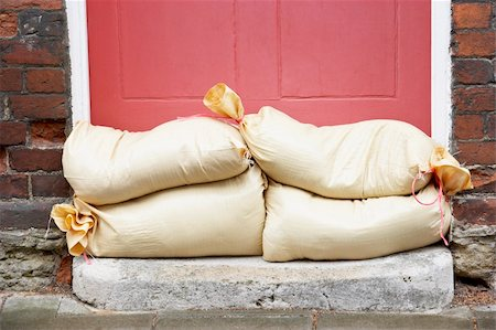 flooded homes - Sandbags Stacked In A Doorway In Preparation For Flooding Stock Photo - Budget Royalty-Free & Subscription, Code: 400-05374281