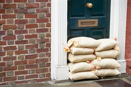 flooded homes - Sandbags Stacked In A Doorway In Preparation For Flooding Stock Photo - Budget Royalty-Free & Subscription, Code: 400-05374282