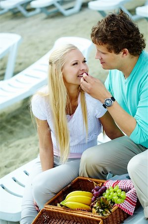 Photo of happy couple having lunch together outdoors Stock Photo - Budget Royalty-Free & Subscription, Code: 400-05374948