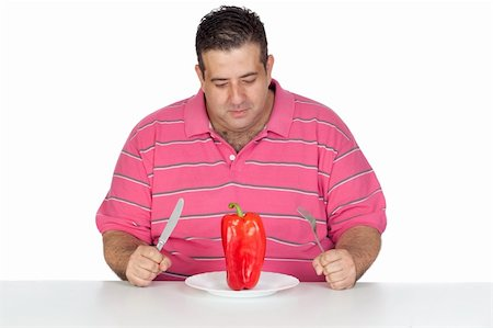 Fat man eating a red pepper isolated on white background Stock Photo - Budget Royalty-Free & Subscription, Code: 400-05376849