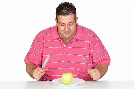 Fat man eating a apple isolated on white background Stock Photo - Budget Royalty-Free & Subscription, Code: 400-05376850