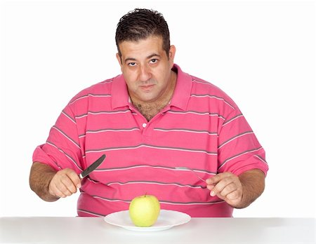 Fat man eating a apple isolated on white background Stock Photo - Budget Royalty-Free & Subscription, Code: 400-05376851