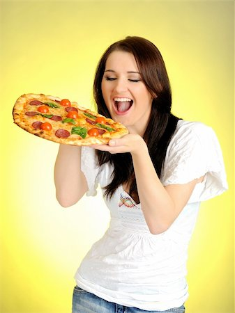 fat italian woman - Pretty young casual woman eating tasty pizza Stock Photo - Budget Royalty-Free & Subscription, Code: 400-05379386
