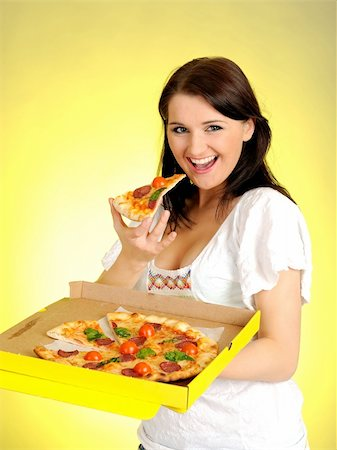 fat italian woman - Pretty young casual brunette girl eating tasty pizza Stock Photo - Budget Royalty-Free & Subscription, Code: 400-05379387
