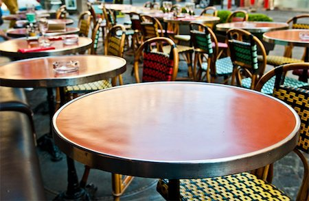 Street view of a Cafe terrace with empty tables and chairs,paris France Stock Photo - Budget Royalty-Free & Subscription, Code: 400-05371274