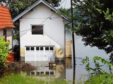 flooded homes - house surrounded by water in river during spring flood in Serbia Stock Photo - Budget Royalty-Free & Subscription, Code: 400-05371382