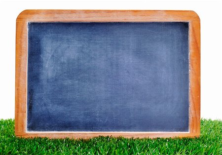 a blank blackboard on the grass to insert such as soccer matches or scores Stock Photo - Budget Royalty-Free & Subscription, Code: 400-05373485