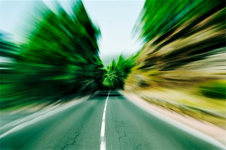view of a road through a wood with motion blur Stock Photo - Budget Royalty-Free & Subscription, Code: 400-05373519