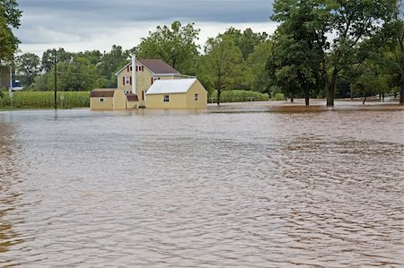 flooded homes - Rising water from the Middle Creek floods a house in Clay,Pennsylvania. Stock Photo - Budget Royalty-Free & Subscription, Code: 400-05373782