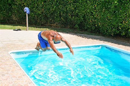 Man jumoing to swimming pool. Stock Photo - Budget Royalty-Free & Subscription, Code: 400-05380214