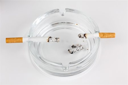 Color photo of a glass ashtray and cigarette Stock Photo - Budget Royalty-Free & Subscription, Code: 400-05380764