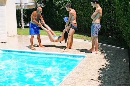 Men  throwing  woman to swimming pool. Stock Photo - Budget Royalty-Free & Subscription, Code: 400-05381058